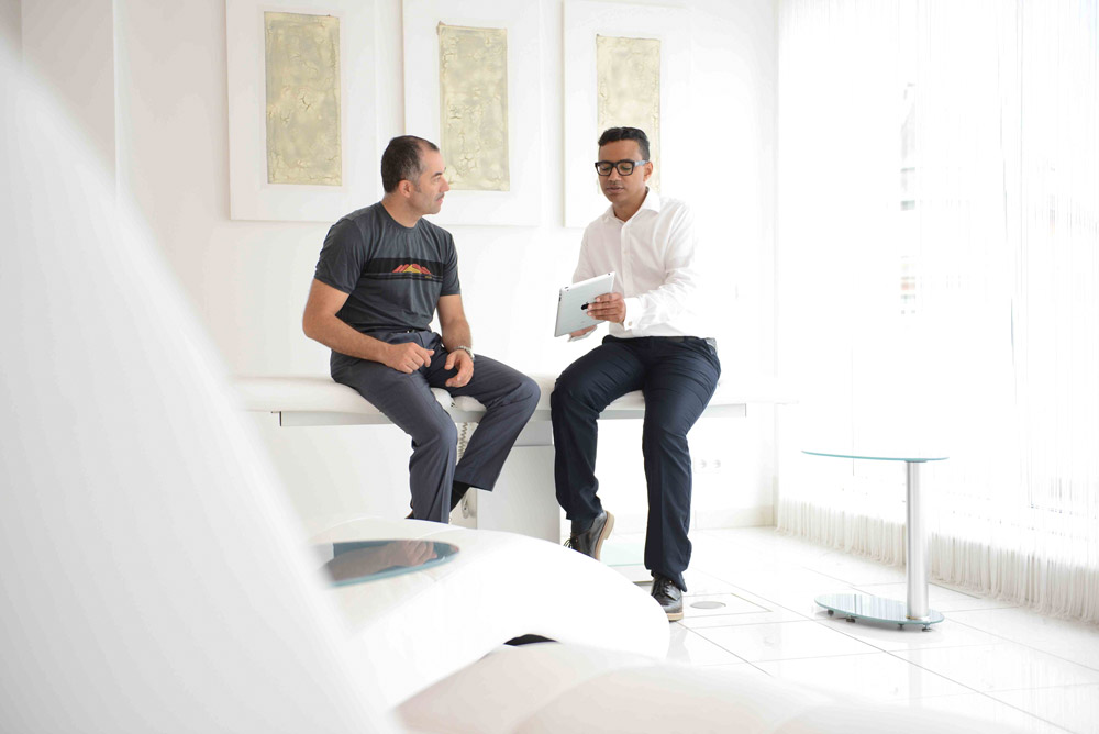 Philip Battiade talks with a Infusio patient